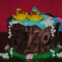 Twin Baby Shower Cake   This is for a baby shower, mom-to-be is expecting twins.. One of each. The rubber ducks have a pink bow and a blue baseball cap.