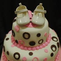 Pink And Brown Baby Shower Cake I am not sure where this photo came from it was sent by a mother to be. Sorry I can not give credit. Shoes are real cake is covered in mff...