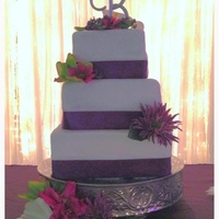 6 Inch 8 Inch 10 Inch Square Cakes Covered In Michelle Fosters Fondant Each Tier Is Trimmed With Satin Ribbon And Silk Flowers 6 inch 8 inch 10 inch square cakes covered in Michelle fosters fondant. Each tier is trimmed with satin ribbon and silk flowers.
