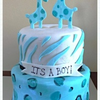 Safari Themed Baby Shower 6 Inch And 8 Inch Round Cake Covered In Michelle Fosters Fondant The Giraffes Were Cut Out Of Gumpaste The Anima... Safari themed baby shower6 inch and 8 inch round cake covered in Michelle fosters fondant. The giraffes were cut out of gumpaste. The...