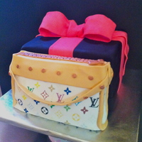 Lv Purse Cake  This is my first attempt at frosting sheets. It was a lot harder than I thought. The purse and cake box are red velvet with cream cheese...