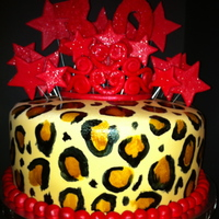 30Th Birthday Leopard Cake   Carrot Cake with cream cheese filling covered in fondant. Hand painted leopard spots with red accents: stars, 30, and tiara.