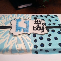Baby Shower Cake With Zebra & Giraffe Print 1/4 sheet baby shower cake made to match the plates for the shower.