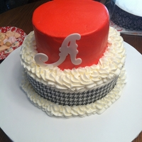 "Alabama Birthday Cake 2 Tier Birthday Cake for Alabama fan. Houndstooth Sugar sheet around bottom tier. Red buttercream icing on top and Fondant ""A""..."
