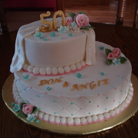 Don And Angie's 50Th   50th wedding anniversary cake. Buttercream with Fondant/gumpaste 50 and flowers. TFL