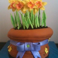 Spring Tulip Cake i mixed gumpaste and MMF to make the flowers, the rest is MMF, the dirt is crushed oreos, this was my first time making daffodils, they...