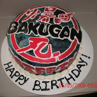 Bakugan Birthday Yellow cake with MMF. I enlarged the design and cut it out. Then i gut the pieces out in fondant. Then i assembled it on the cake and...