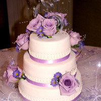 Purple Rose Wedding Cake Groom was so thrilled with his cake he boasted the whole reception that he custom designed it himself! LOLWhite chocolate cake filled with...