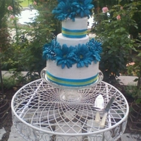 Rivera Wedding Blue and yellow themed wedding reception! The cake turned out so well that the bride said it was better than her first cake! (They had two...