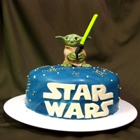 "Yoda Birthday Cake Star Wars themed birthday cake for a friend at work. He absolutely loved it! Yoda is made out of fondant. The cake is an 8"" banana..."