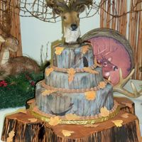 For A Hunter  The 3-tier cake frosted with buttercream, then covered with rolled fondant. I wish I could claim the deer head, but it is ceramic. The cake...