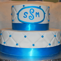 Bridal Shower 6 and 10 in cake covered with fondant. Dragees dusted with peacock blue luster dust and blue satin ribbon!