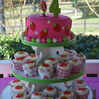 "Strawberry Shortcake 4Th Birthday 8"" fondant covered vanilla-rainbow sprinkle cake. Matching cupcakes with strawberry fondant toppers!"