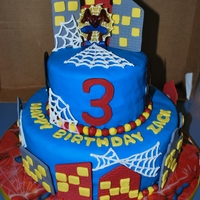 Spiderman 3Rd Birthday Cake A 6 and 10 inch fondant covered cake. Fondant/gum paste buildings, color flow spiderman heads, royal icing spiderwebs, and buttercream...