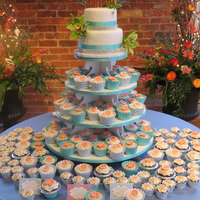 Wedding 6 and 8 inch round wedding cake, with ribbon and rhinestone ribbon. 150 cupcakes with fondant toppers