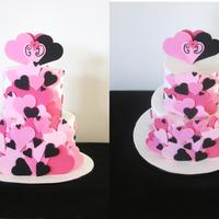 Fanned Hearts Wedding Cake. This cake was inspired by a design by scrumptious cakes in the UK. Bride and groom found it in white,but wanted it in their colour scheme...