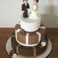 Browns And Ivory Wedding Cake. Topper is hand made from icing.