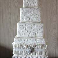 Lace & Brooch  This 4 tier wedding cake is completely covered with pressed laced. The bottom tier was made a little taller than usual; at 7 inches tall,...