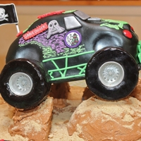 Grave Digger Monster Truck Fondant Grave Digger Truck, RKT wheels covered in black fondant. Styrofoam mountains covered with royal icing and graham cracker crumbs....