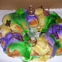 New Orleans Style Traditional King Cake Original Recipe with butter glaze and colored sanding sugas