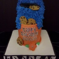 Cookie Monster/zebra Cake  Got an order for a Cookie Monster cake for a 14yr old, found a design on CC by mom2twogrlz that I loved, this is my interpretation of that...