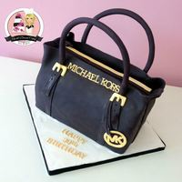 Michael Kors Purse Cake Carved from an 11 X 14 cake. I am very very pleased with how this turned out.