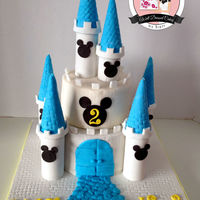 Disney Themed Castle Cake 2 tier fondant Castle Cake. Turrets are made from toilet paper rolls and waffle cones! Love how this turned out.