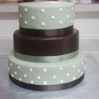 Sage Green And Brown Wedding Cake This was my first wedding cake done for a neighbor. It was a 12, 10, 8 inch cake made of chocolate and white cake. The middle layer was...
