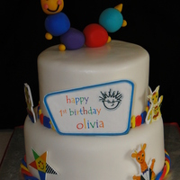 Baby Einstein First Birthday This was for my baby girl's first birthday. Top layer is yellow cake with lemon BC, bottom layer is chocolate cake filled with...