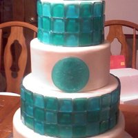 Blue Crush Fondant with poured sugar tiles in teal and sky blue. Blown sugar balls on the top and sugar poured into circle mould down the center