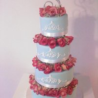 Something Blue Light blue fondant with royal icing scroll work and fresh roses :)