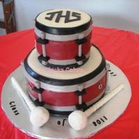 Bass Drum And Mallets  Marshmallow fondant covered vanilla and chocolate cakes. Mallets are made with dowels, candy melts, RKT, and fondant strips. The wear on...