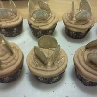 Pirate Coin Cupcakes Pirate coin cupcakes with gold sparkles