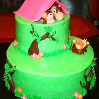 Camping Cake a camping and horseback riding cake with a lit campfire. all figures are made with fondant