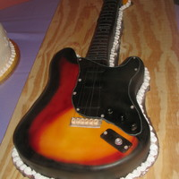 Fender This was a grooms cake for a musician, it was a copy of his guitar and the exact size of it. I traced his guitar and carved the cake from...