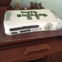 Xbox Birthday Cake Sorry for the picture quality...I made this for one of the boys in my son's scout troop...yellow cake carved by hand with all...