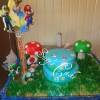 Mario Bros Cake is in buttercream and details on gumpaste