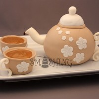 Tea Pot Cake for a small family gathering with some family members visiting from England. Small sports ball pans for teapot and mini doll pans to...