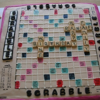 Scrabble Cake Here is a Scrabble Cake I made for a friend's birthday. I was asked to incorporate her favorite things into the tiles.