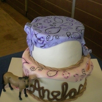 Anela  Birthday cake for a little girl who's party was at the horse stables...everything fondant except for the horse...drew the bandana...