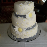 "Daisy Wedding Cake 8"", 10"", 12"" rounds with MFF, and gumpaste flowers"