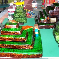 Minecraft Cake the larger landmass is orange dream and the smaller is red velvet. the trees are rice krispy treats airbrushed green. all of the details...