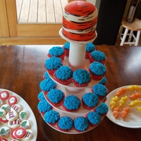 Dr. Seuss Themed Baby Shower Treats Cookies, Lorax mustaches, Thing one and two cupcakes, and a small striped hat cake on top!