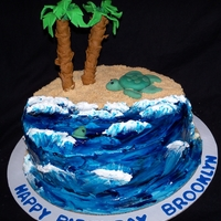 Ocean Waves And Sea Turtle buttercream with piping gel for the water, ground cinnamon toast crunch for sand. gumpaste tree with pretzel rod as the base for the trunk...