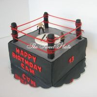 Wwe Ring   Marble cake with cookies n cream SMBC filling and vanilla SMBC frosting.