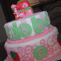 Strawberry Shortcake This is the cake I made for my daughters 5th birthday. I so need to practice my scroll work, but it sure was fun.