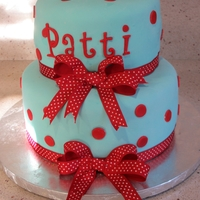 Blue & Red Polka Dots I made this for my best friends 40th. Covered in MMF and got lazy and put a ribbon on the cake.