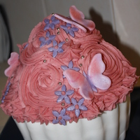 Butterfly Giant Cupcake I made this for my daughters 6th Birthday.I used a giant cupcake tin. Cake was mudcake with a strawberry buttercream icing top and white...