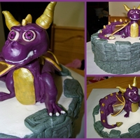 "Skylander Spyro Cake 10"" round with purple dragon. Body of dragon is cake, covered in candy clay... head, tail, legs, wings are candy clay."