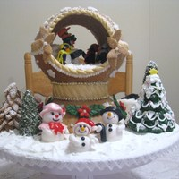 Snowglobe Snowglobe, base,and some of the trees are all made from gingerbread. Penguins and snow family are fondant